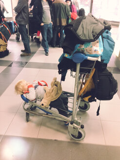 Child at airport at baggage trolley, Palermo, Sicily, Italy - MEA000031