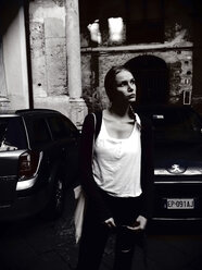 Young woman standing in the streets of Palermo, Sicily, Italy - MEAF000080