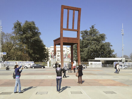 Broken chair in front of the United Nations in Geneva, memorial for banning cluster bombs for ever from artist Daniel Berset, Switzerland - SE000406