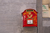 Belgium, Brussels, old red letter box with graffitis hanging on house facade - WG000198