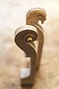 Scroll of a violin in a violin maker's workshop - TCF003798