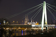 Germany, North Rhine-Westphalia, Cologne, Severinsbruecke and Cologne cathedral by night - JATF000558