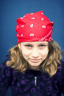 Portrait of smiling girl with red headscarf - PAF000251