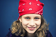 Portrait of smiling girl with red headscarf - PAF000248