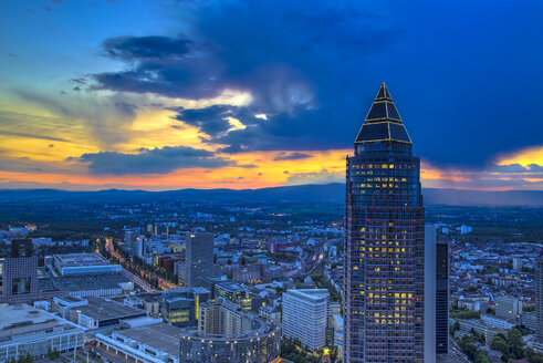 Germany, Hesse, Frankfurt am Main, Trade Fair Tower and city view at sunset - TI000002