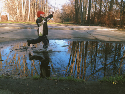 Little boy has found a puddle. Berlin, Germany. - ZMF000096