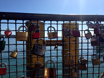 Padlocks on screen in front of Lake Constance, Germany, Baden-Wuerttemberg, Constance - JEDF000082