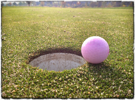 Golf Ball on Green just in front of the hole - MVC000057
