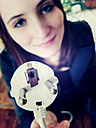 Young woman with a power plug in the hand - JATF000586