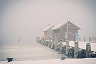 Germany, Mecklenburg-Western Pomerania, Ruegen, Pier in Gager in winter - MJF000670