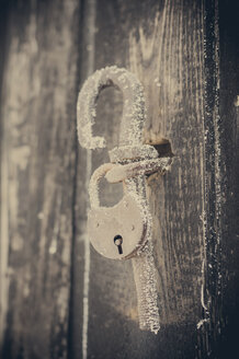 Frozen padlock at wooden door - MJF000672
