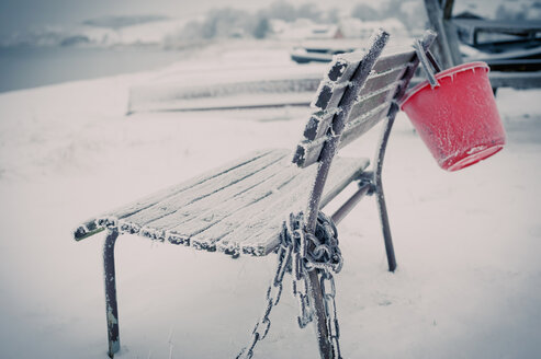 Germany, Mecklenburg-Western Pomerania, Ruegen, Empty bench in winter - MJF000593