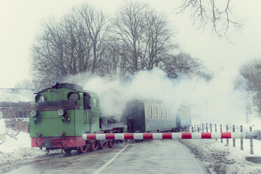 Germany, Mecklenburg-Western Pomerania, Ruegen, Steam train Rasender Roland in winter - MJ000596