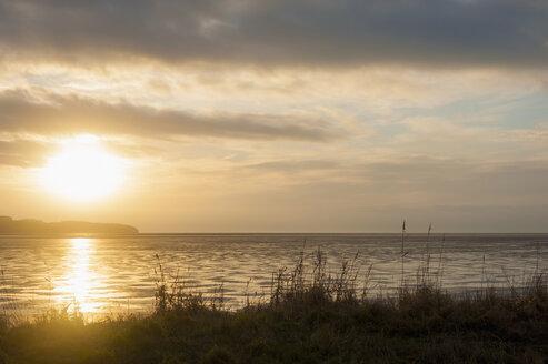 Germany, Mecklenburg-Western Pomerania, Ruegen, Sunset at Middelhagen - MJF000561