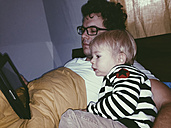 Father and son watching a video on a tablet, Bonn, North Rhine-Westphalia, Germany - MFF000788