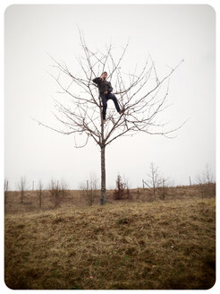 Teenager in a Tree, Germany - MVC000066