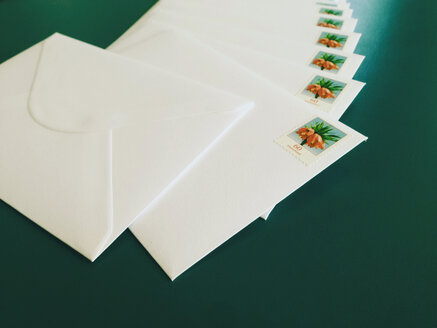Envelopes with stamps 60ct laying on a table - MF000785
