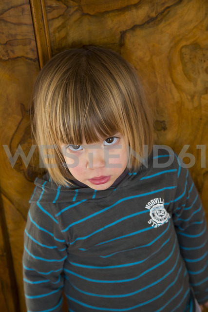 Portrait of little girl leaning at a wardrobe - LVF000500