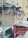 Germany, Bavaria, Munich, bicycle hanging on road sign - BR000043