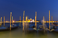 Italy, Venice, Gondolas at San Giorgio Maggiore at night - FOF005823