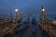 Italy, Venice, Gondolas at San Giorgio Maggiore at night - FO005649
