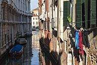 Italy, Veneto, Venice, boats on canal,  laundry on clothesline - FOF005894