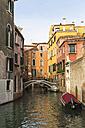 Italy, Veneto, Venice, Houses, bridge, boats on a canal - FO005876
