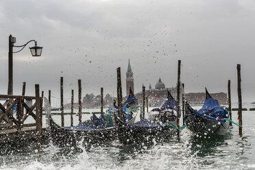 Italy, Venice, Gondolas and church San Giorgio Maggiore at high watermark - FOF005942