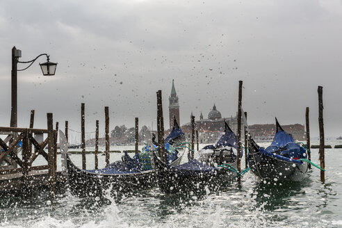 Italy, Venice, Gondolas and church San Giorgio Maggiore at high watermark - FOF005942