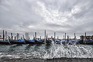 Italy, Venice, Gondolas and church San Giorgio Maggiore at high watermark - FOF005944