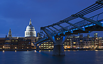 United Kingdom, England, London, View of Millennium Bridge with St Pauls Cathedral in background at night - JB000013