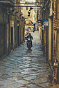 Italy, Sicily, Palermo, Man on motor bike in narrow lane with pidgeons - MF000813