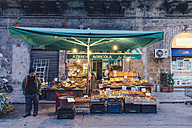 Italy, Sicily, Palermo, Man standing in front of his fruit shop - MF000820