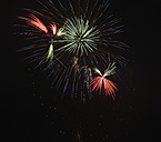 Germany, Bavaria, Kochel am See, fireworks at night sky - LA000471