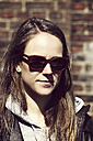 Portrait of young woman wearing wooden sunglasses - HOHF000403