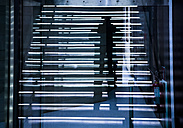 Italy, Rome, mirrored silhouette of photographer at museum MAXXI - DIS000448