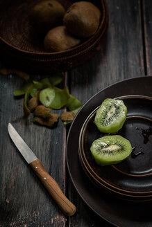 Peeled and sliced kiwi fruit on plate - SBDF000491