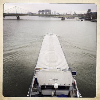 Rhine, large transport vessel going upstream on the Rhine river, Cologne, Germany - ZM000159