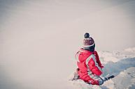 Germany, little boy having fun in snow - MJF000778