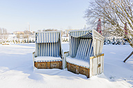 Germany, two snow covered hooded beach chairs - MJ000781