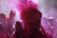 India, Uttar Pradesh, Vrindavan, senior during Holi, spring festival, festival of colours - JBA000030