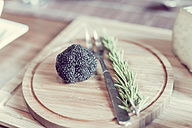 Wooden plate with truffles and rosemary - MJF000854