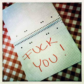 Fuck you written in red letters in ring binder - DRF000478