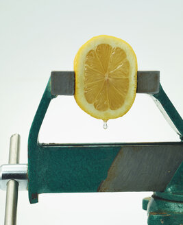 Squeezing half of a lemon with bench vice - AKF000307