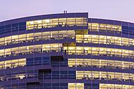 Germany, Baden-Wuerttemberg, Stuttgart, facade of office building at twilight - WDF002242