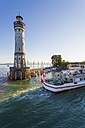 Germany, Bavaria, Lindau, View of light house with excursion boat in lake - WD002247