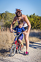 USA, Texas, Mother helping son riding bicycle - ABAF001210