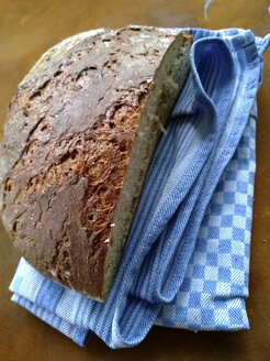half rye bread on a dish towel - MYF000136