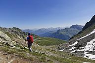 Austria, Vorarlberg, Woman hiking at Grafierjoch, Schmalzberg and Valiserapitze in background - SIEF005037