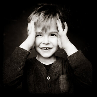 Smart Portrait of a Three Year old Toddler, Playing Peekaboo, Berlin, Germany - MVC000110